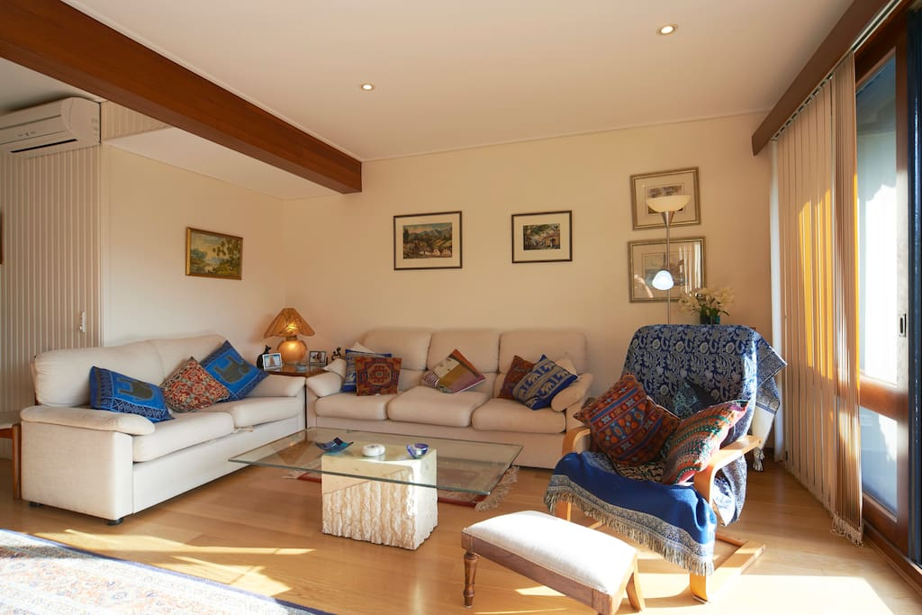 The living area with cushion collection and art from places I have travelled.