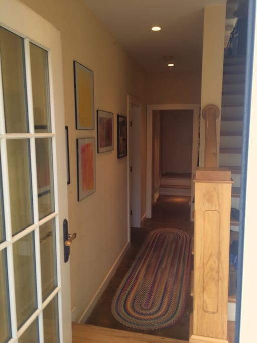 This is the entrance to the apartment, which is at the same level as the back yard, a permaculture paradise! We live upstairs, and you will not need to interact with us, if you don't want to.