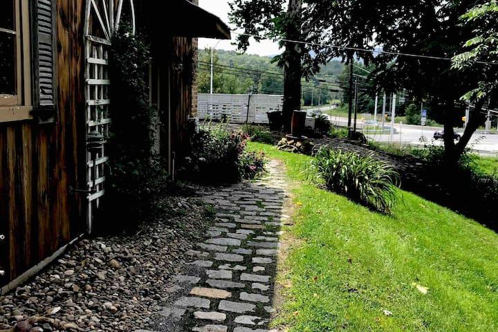Sidewalk leading to room