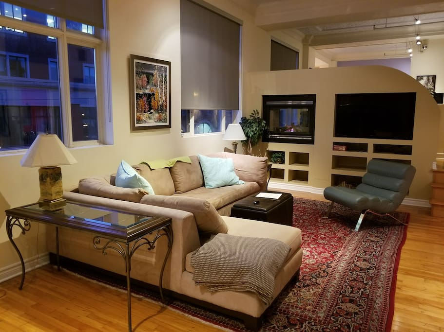 living room view toward sleeping area