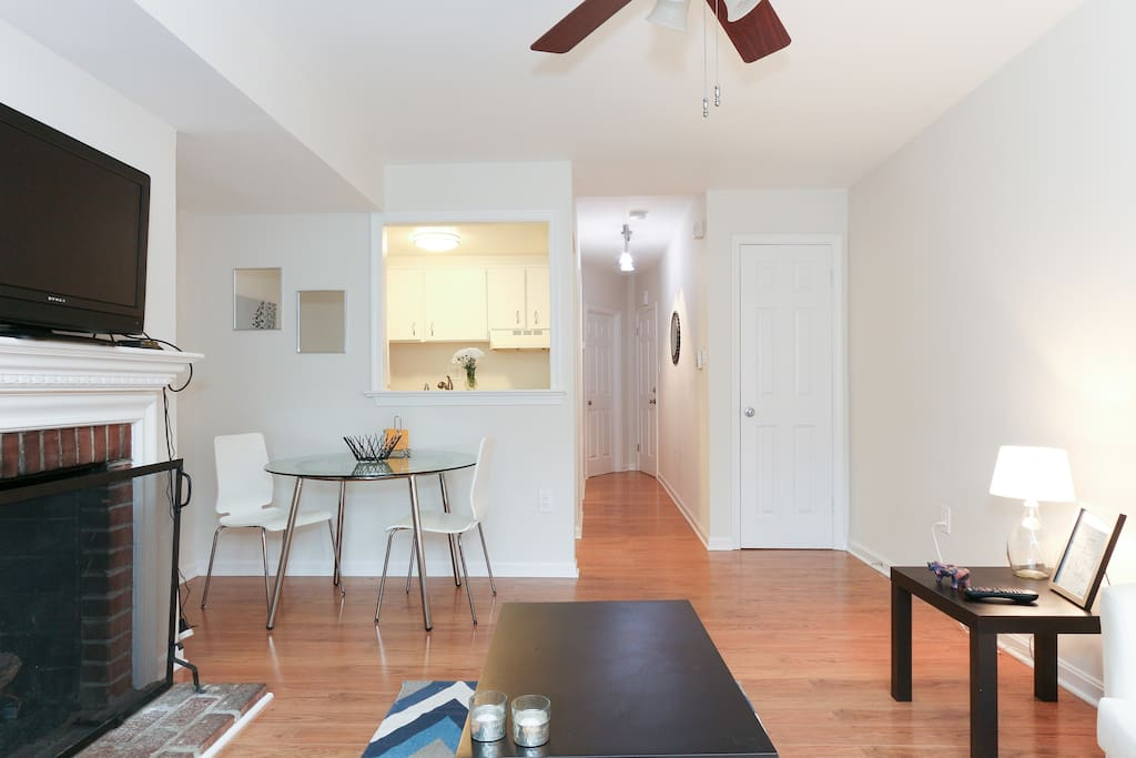 Open floor plan allows plenty of light while also providing for privacy between the bedroom and living area.