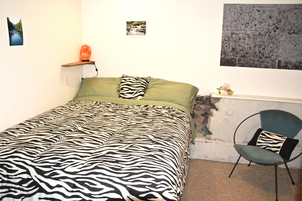 Bedroom accommodates 2 with Queen size Bed and Walk-in-closet.
