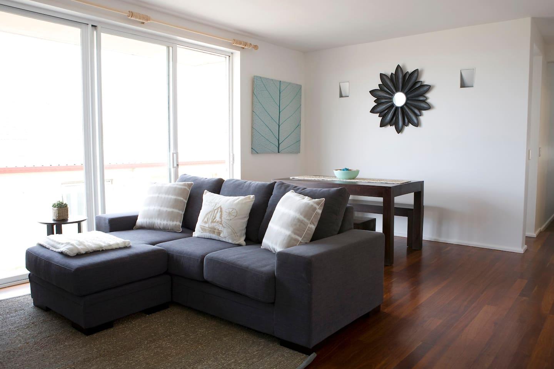 Spacious living room with balcony facing Bondi Beach