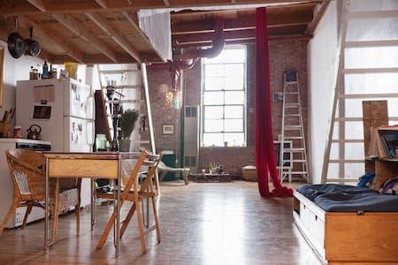 we offer a room in a artist loft in bushwick.    the neighborhood is vibrant.    the room has a queen bed and an air mattress to accomodate parties of two or more.