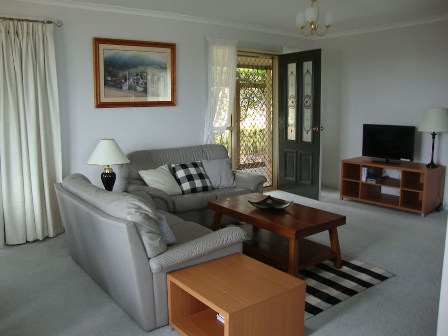comfortable living room.  dvd's available and good selection of books