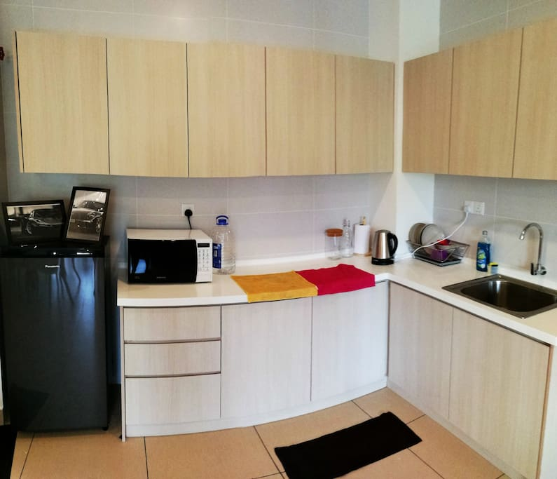 Kitchen come with fridge, microwave, kettle, and induction cooker. All plate, bowl, spoon, folk pot and kitchen equipment is provided.