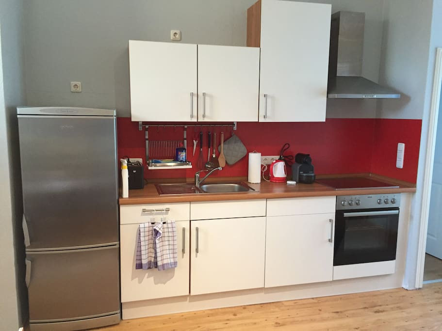 kitchen with huge fridge/freezer, oven and washing machine/dryer