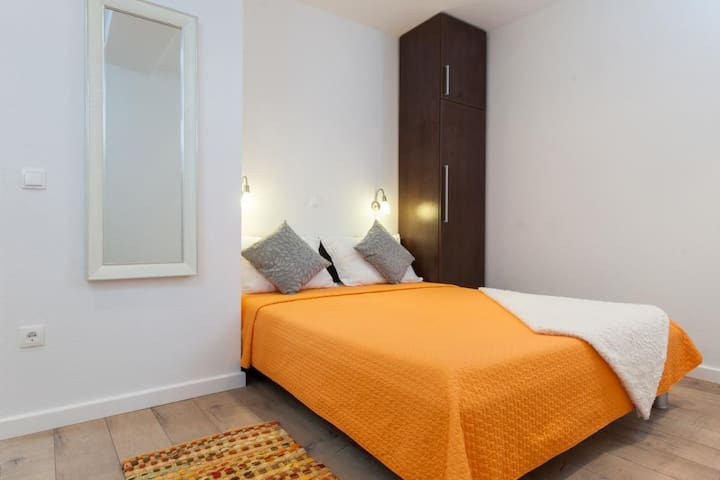 Second sleeping room with double bed.