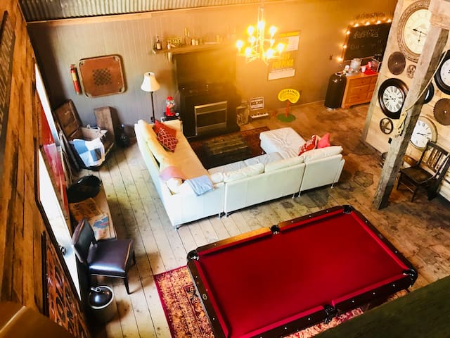 The great room features an open space for lounging, playing, and rehashing memories of years past.