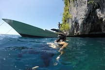 Snorkeling into a cave on Seram Island