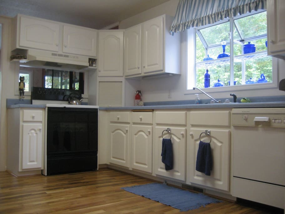 Full kitchen with all dishes, unsettle, pots and pans.  Toaster, coffee maker, microwave, dishwasher, refrigerator.