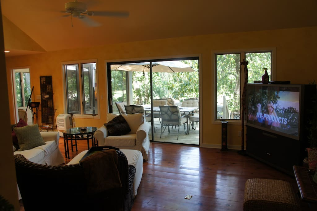 This spacious living room is quiet and comfortable with an amazing view of the golf course.