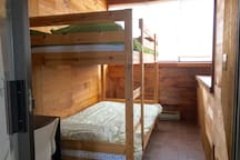 The fourth bedroom features twin sized bunk beds