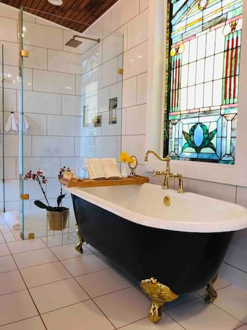 Who doesn't want to bathe in a romantic tub large enough for two underneath a 100 year old stain glass window??