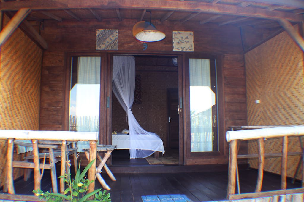 a classic room with a very traditional bamboo stail making room equipped with ac, wifi, warm water, and double bed, perfect for those of you who long for a rustic atmosphere with modern facilities