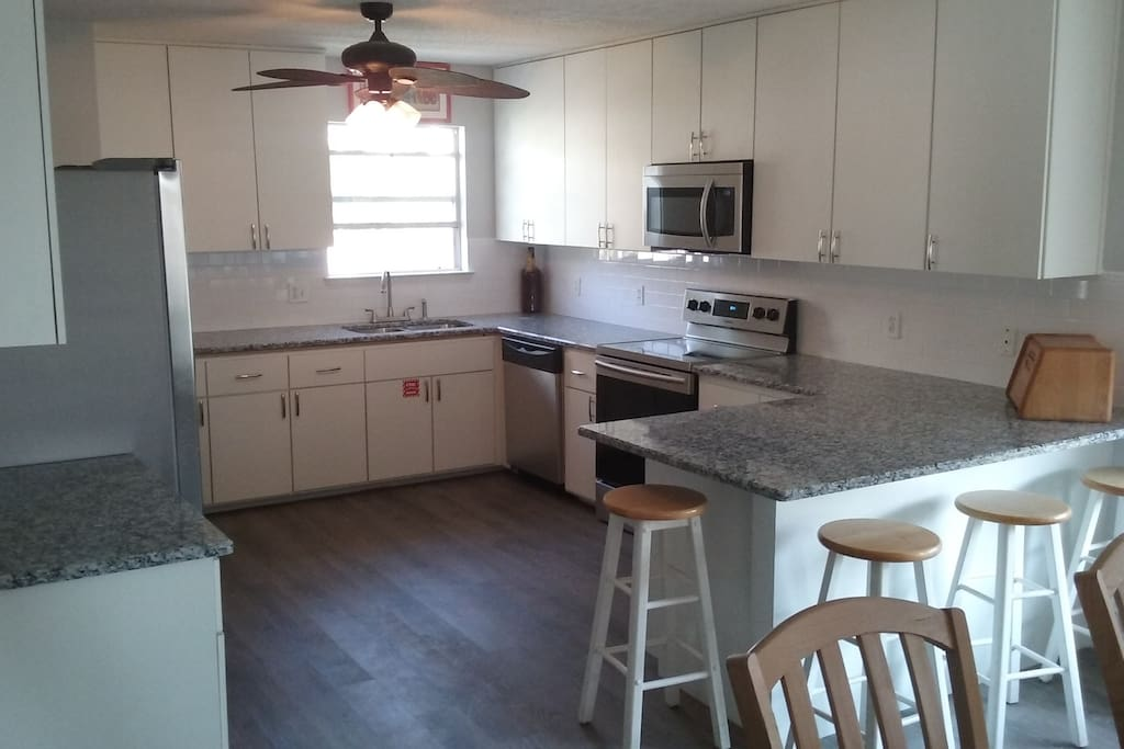 GRANITE, ALL STAINLESS, TONS OF CABINETS,