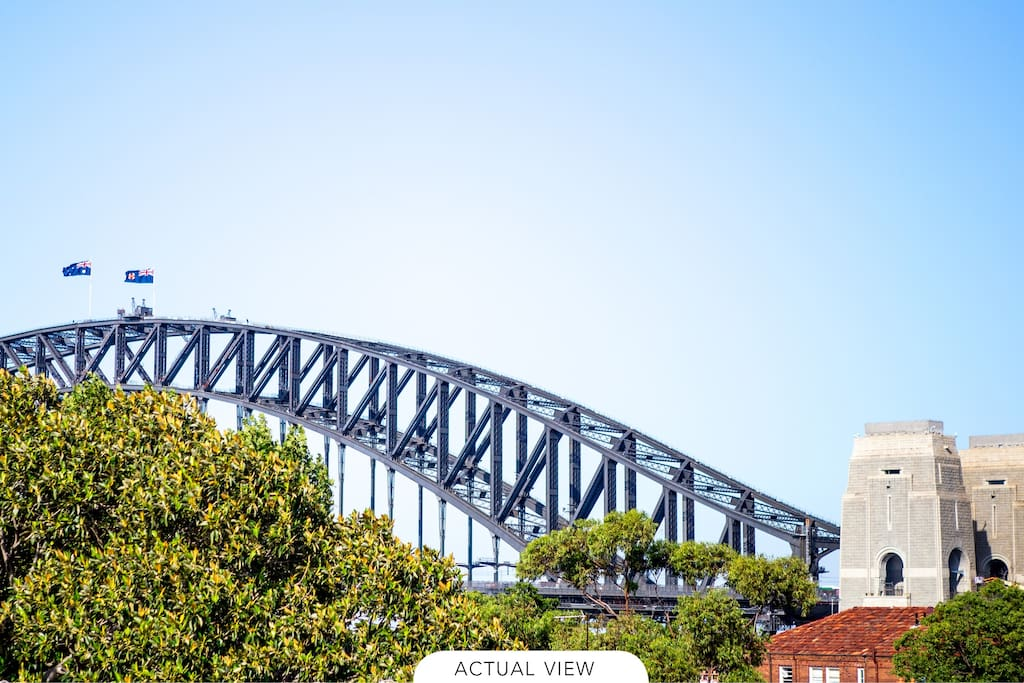 Views of the Sydney Harbour Bridge from the balcony by day