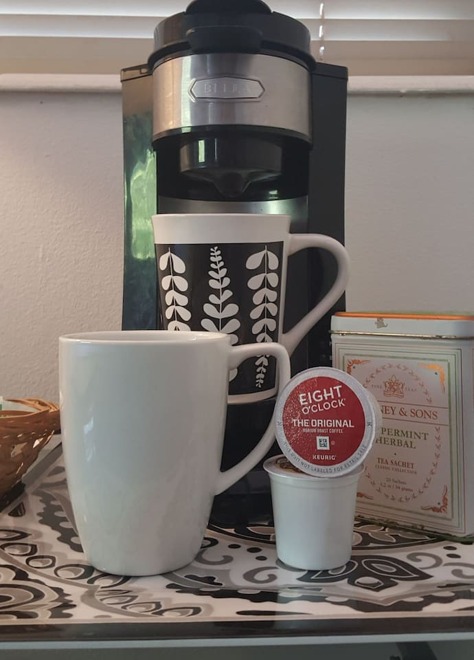 Coffee/tea & refrigerator in room