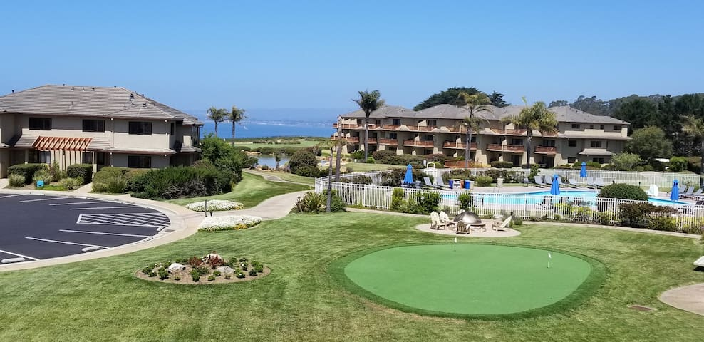 View of the ocean, pool and putting green from our villa