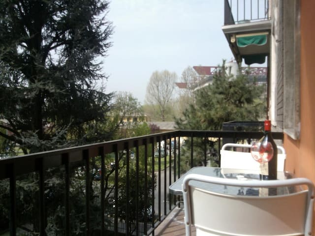 Balcony with breakfast table & chairs. In the background is the San Siro football stadium. Free parking in front of the condo.