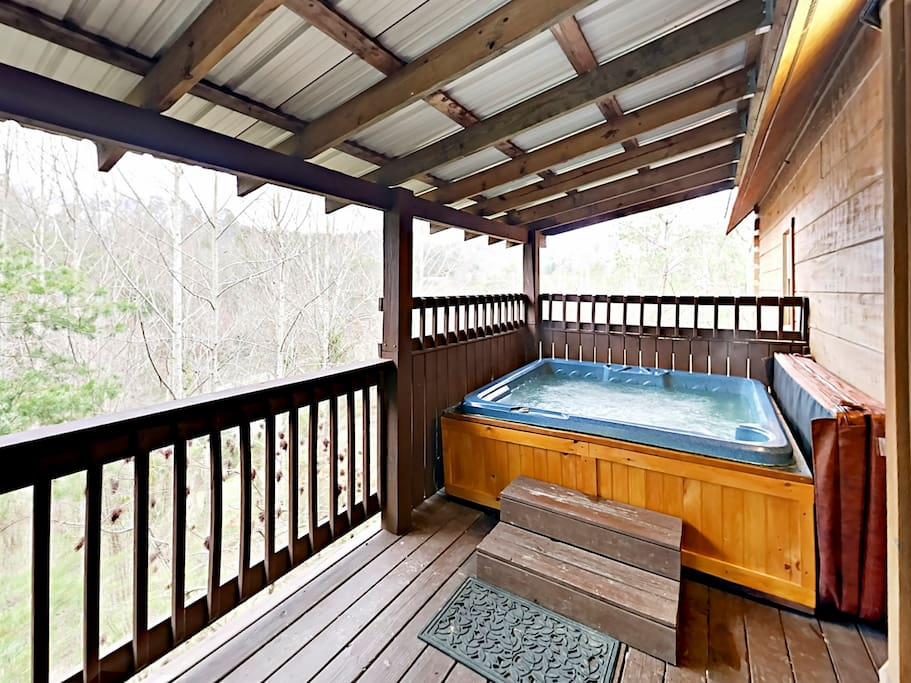 Take a soothing soak in your private hot tub.