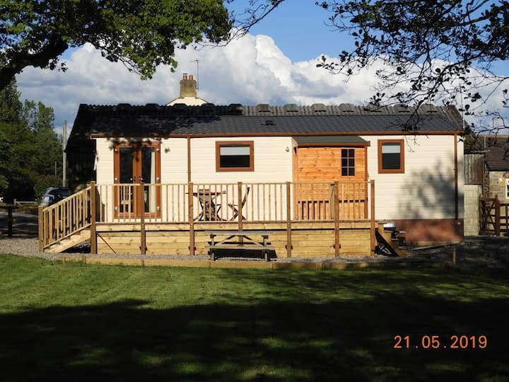 spacious and brand new lodge  in private garden