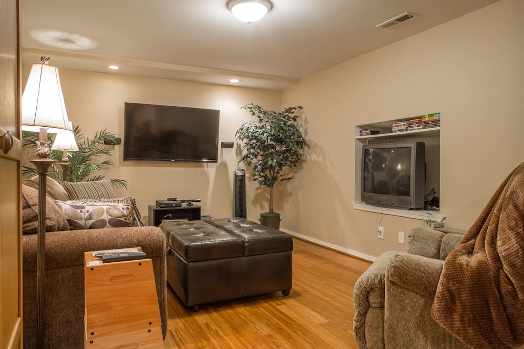 "Large living area with 55"" flat screen TV, and a queen size pull out sleep sofa with memory foam mattress."