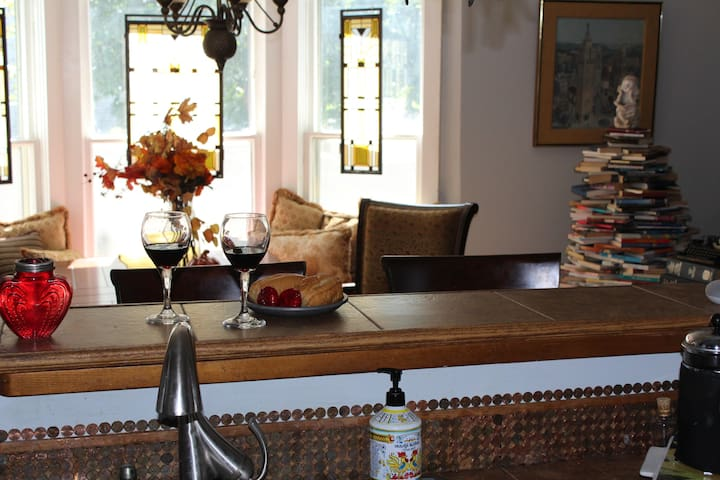 Kitchen cutout window over bar looking into dinning room and reading nook