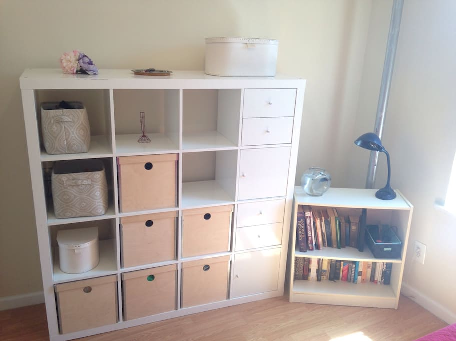 Storage for your trinkets and some books to peruse.