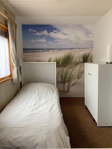 Slaapgedeelte woonkamer 1 bed