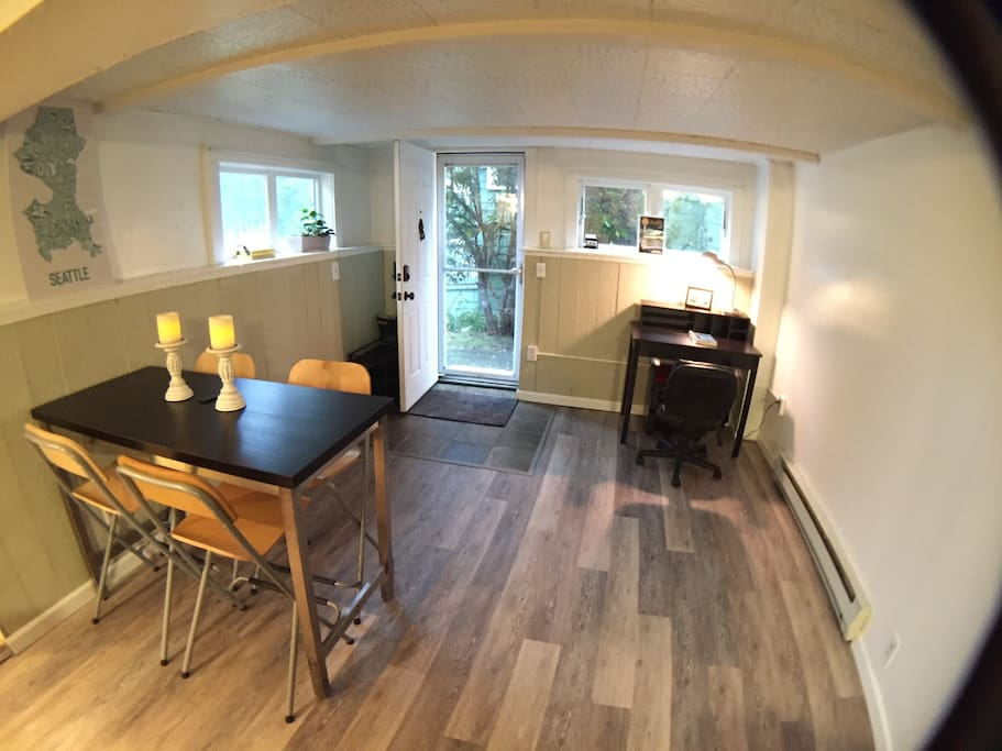 Daylight basement apartment, opens at ground level. Dinner table for four and work desk. Also room for queen-sized inflatable bed.