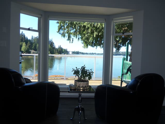 Enjoy your morning coffee on the big comfy chairs in the living room while taking in the serene beauty of the bay.