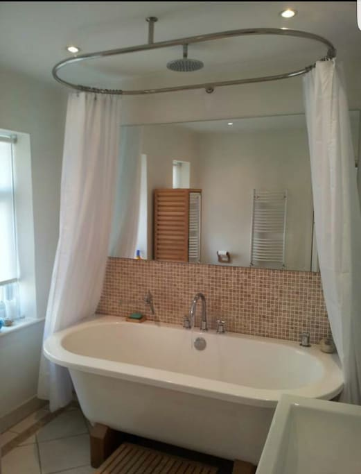 Shared bathroom with shower and bath.