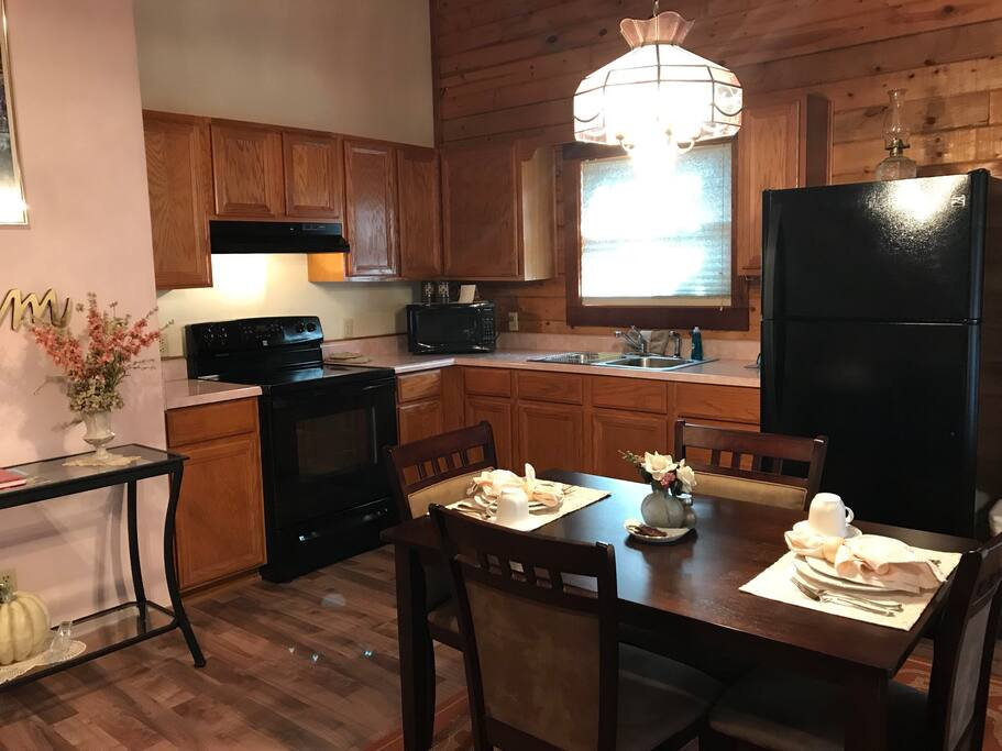 Somewhere in Time, Cabin 4 has a full kitchen and dining area