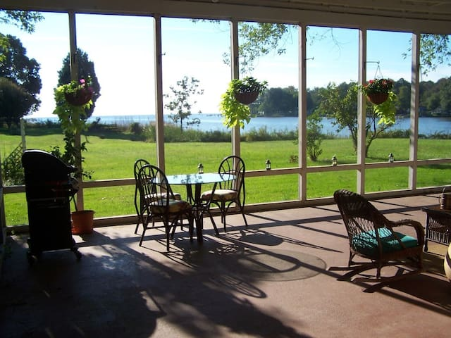 Screened-in porch overlooking the Chesapeake.
