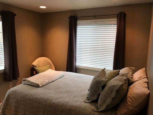 Super comfy bed with extra pillows and blankets available!  Black out curtains on the windows