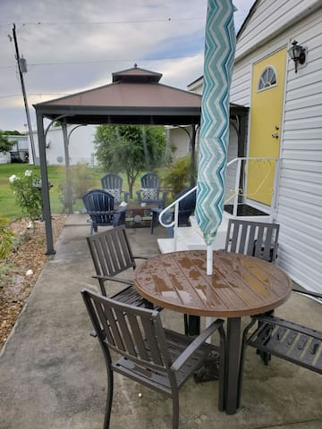 New table and chair with umbrella added outside. Nice place to enjoy dinner or drinks.