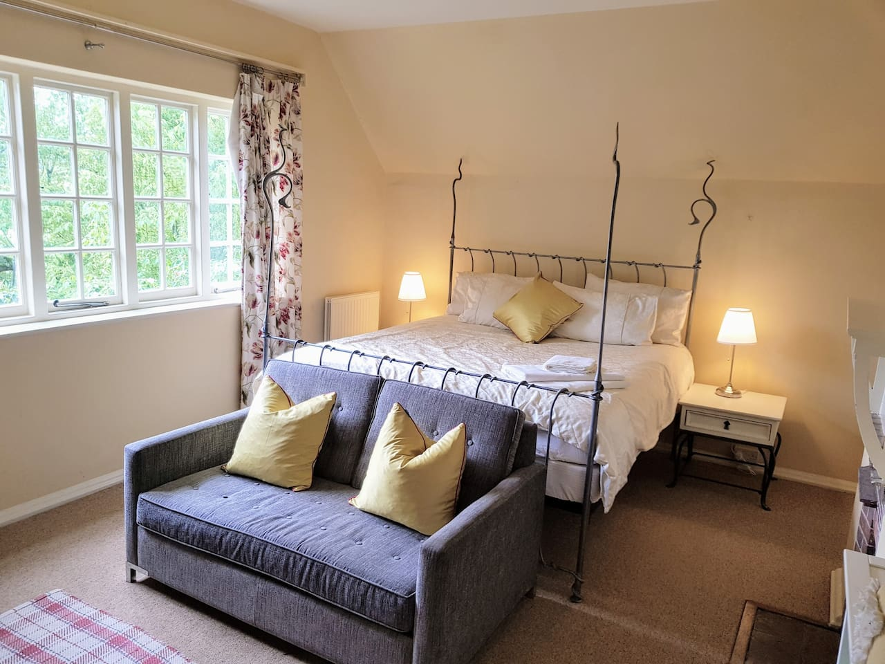 "Corfe Room with views over the stream and watercress meadows. Large Room with Super King Sized Bed large sofe and internet 40"" HD TV, netflix, prime, youtube etc, Private En Suite with Victorian Cast Iron Rolled Bath and Victorian sanitary ware."
