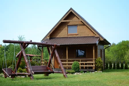 Comfortable cabin with playground for kids.
