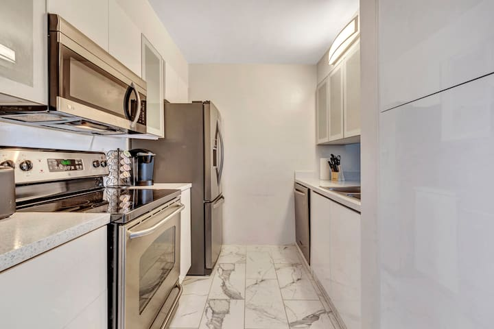 Kitchen with stove, refrigerator and dishwasher.