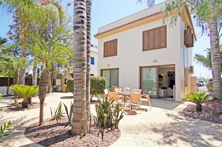 Revi-beach front family villa with roof terrace