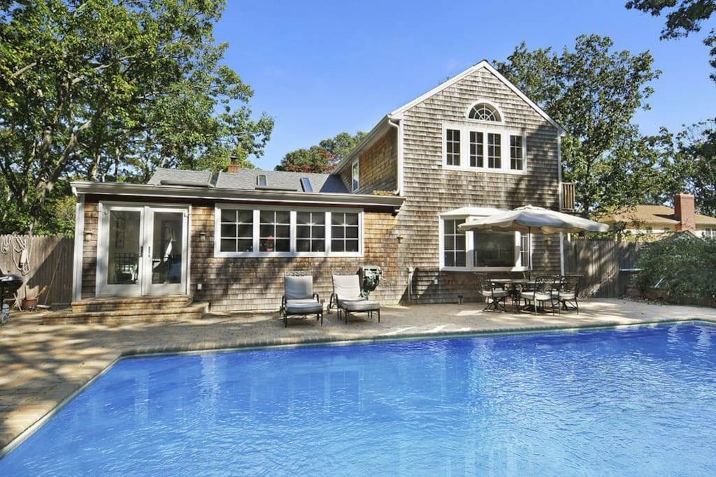 Back yard, two French doors open to the pool from the kitchen