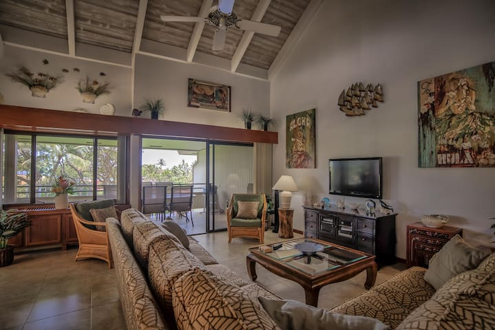 Spacious living area with direct access to a large lanai with views of the ocean and West Maui mountains.