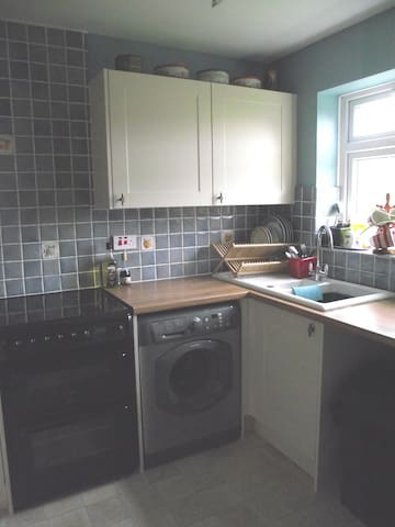Shared kitchen including washing machine, dishwasher and mircowave