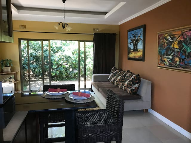 Spacious living area with free cable TV and high-speed internet. Within walking distance to Cross Roads Mall, with two other malls within 1-2Km.