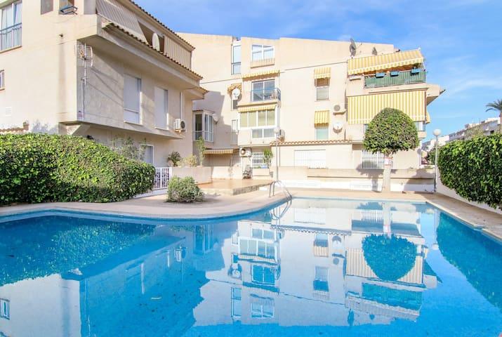 Modern apartment w/ shared pool & gym + terrace views - close to the beach!
