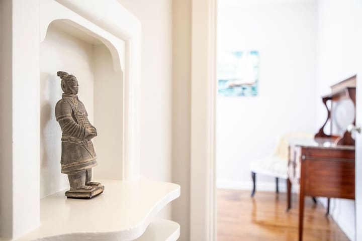 The place has beautiful architectural details, including this phone niche and gorgeous carved crown molding