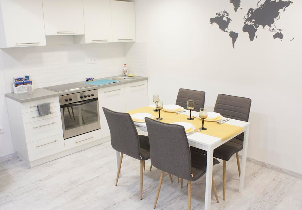 kitchen with the dining table, which can be suitable for up to 6 persons