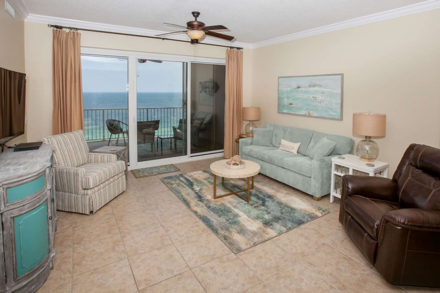 Tiled living room w/access to Gulf-front balcony