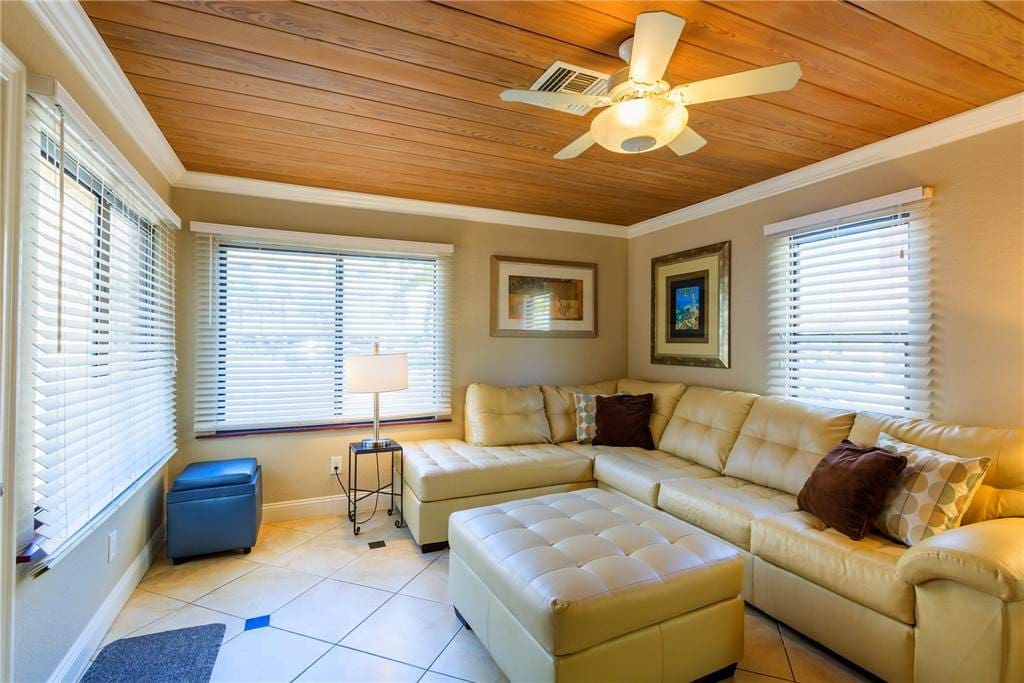 Sunny family room has windows on three sides North, East and West.
